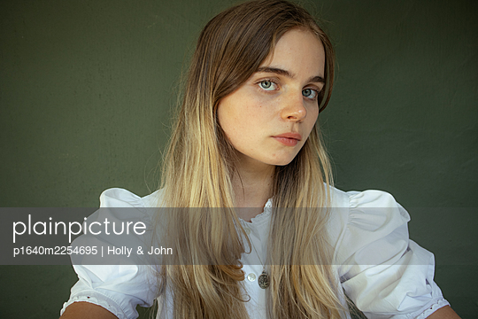 Young woman with long blond hair - p1640m2254695 by Holly & John