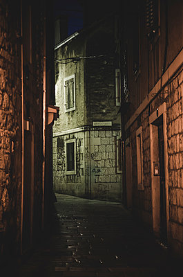 Dark Alley at Night, Split, Croatia - p694m1403850 by Eric Schwortz