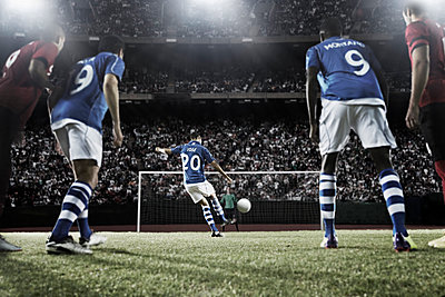 Soccer player kicking ball at goal - p1023m883620f by Chris Ryan