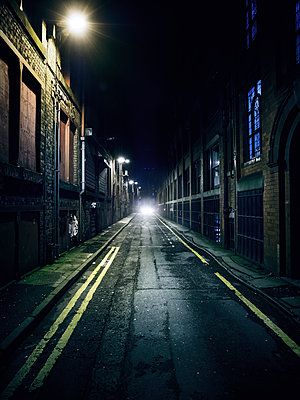 Car in dark alley - p1280m1578210 by Dave Wall