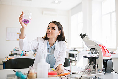 Young researcher in white coat working in lab - p300m2250206 by Hernandez and Sorokina