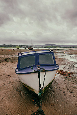 Motor boat at low tide - p597m1564565 by Tim Robinson