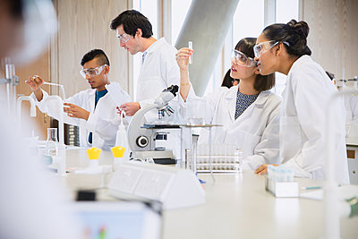 College students conducting scientific experiment in science laboratory classroom - p1023m1192506 by Sam Edwards