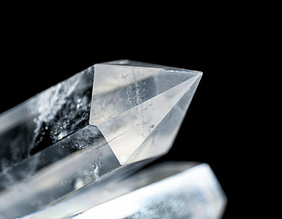 Quartz crystals on black background - p1427m2186328 by Tetra Images