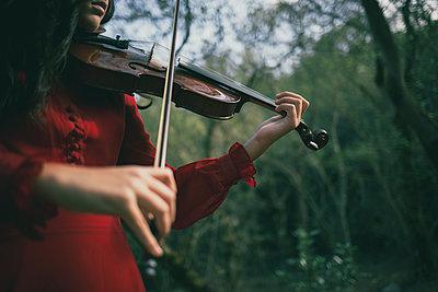 Girl playing violin - p1623m2214895 by Donatella Loi