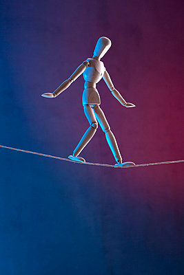 An artist's figure walking a tightrope - p301m730739f by Larry Washburn
