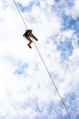 Zip line in the sky - p445m1496596 by Marie Docher