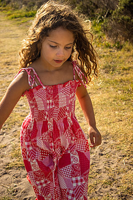 Little girl in red summer dress - p1640m2246116 by Holly & John