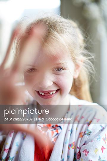 Blond girl with gap between teeth - p1612m2223707 by Heidi Coppock-Beard