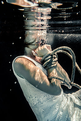 Woman Tied Up with Rope Drowning Under Water  - p1019m2107497 by Stephen Carroll