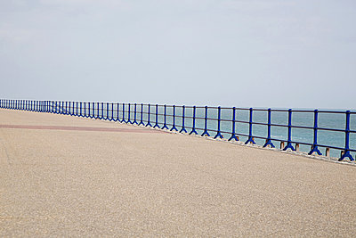 Blue railings and promenade - p9242475f by Image Source