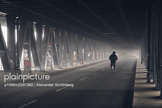 Lonely cyclist - p1696m2291362 by Alexander Schönberg