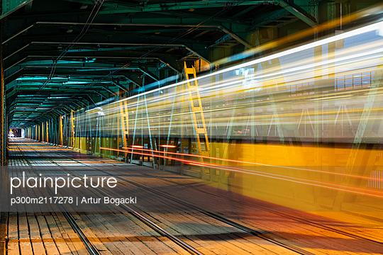Gdanski Bridge at night with tram light trails, Warsaw, Poland - p300m2117278 by Artur Bogacki