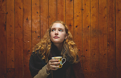 Woman having coffee in cafe - p1315m2062639 by Wavebreak