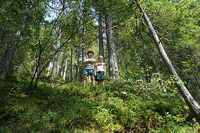 A brother and sister discovering the forest - p1610m2204914 by myriam tirler