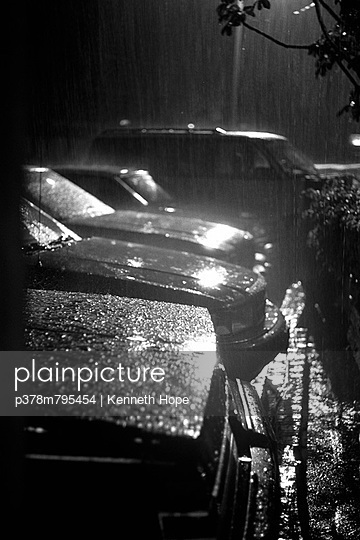 Parked cars in rain - p378m795454 by Kenneth Hope