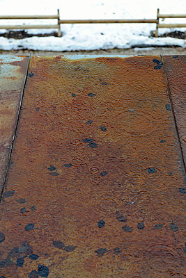 Rain splash on rusty roof - p1048m1123543 by Mark Wagner
