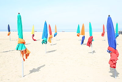 Parasols on the beach - p1289m2089476 by Elisabeth Blanchet
