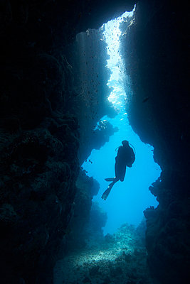 Diver in underwater cave - p4298029 by Zac Macaulay