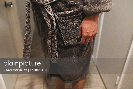Man in bathrobe - p1301m2196186 by Delia Baum
