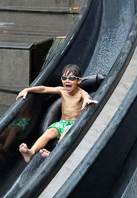 Kid in Toboggan Slide - p664m900901 by Yom Lam