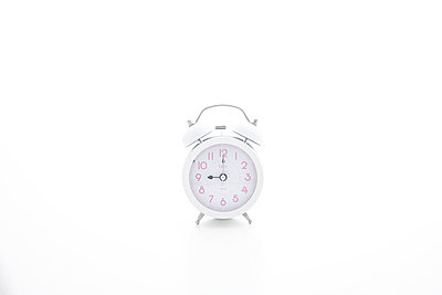 A single white alarm clock - p5147002f by Opus photography