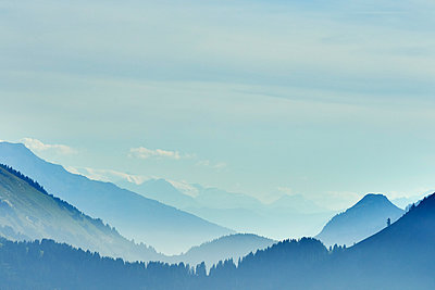 Mist over mountain ranges, Manigod, Rhone-Alpes, France - p429m2069172 by Ross Woodhall