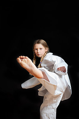 Girl practicing judo - p515m866481 by E.Coenders