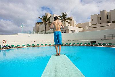 Boy on diving board - p1082m1538966 by Daniel Allan