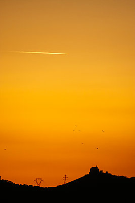 Chemtrails on orange Twilight - p1085m1162747 by David Carreno Hansen