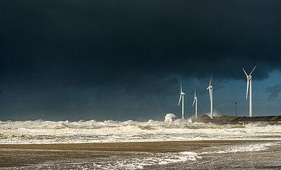 Four wind turbines amidst fierce storm waves and clouds at coast, Boulogne-sur-Mer, Nord-pas-de-Calais, France - p429m1135489f by Mischa Keijser
