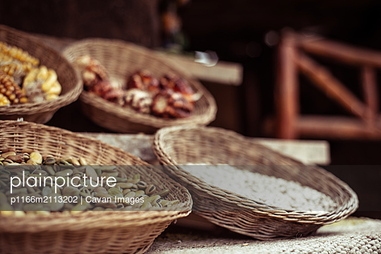 woven baskets of native seeds grains and maze in sacred valley - p1166m2113202 by Cavan Images