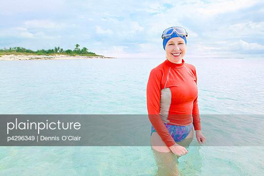 Woman in tropical sea - p4296349 by Dennis O'Clair