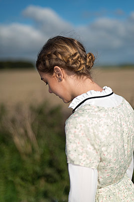 Teenage girl in vintage blouse and floral dress - p1433m1525585 by Wolf Kettler