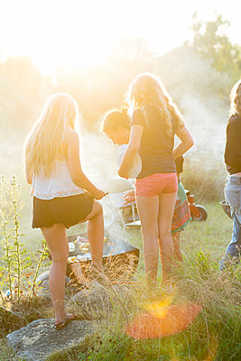 Mother with teenage daughters having barbecue - p312m992966f by Ulf Huett Nilsson
