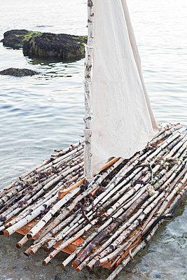 Raft on beach - p956m892320 by Anna Quinn
