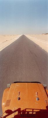 Off-road vehicle on desert road, Sahara desert, Egypt - p3012202f by fStop