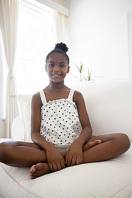 Dark-skinned girl in polka-dotted skirt - p1640m2254589 by Holly & John