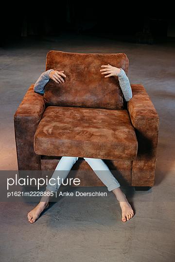 Girl in armchair - p1621m2228885 by Anke Doerschlen