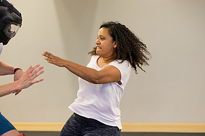 Woman training for self defense - p445m1503888 by Marie Docher