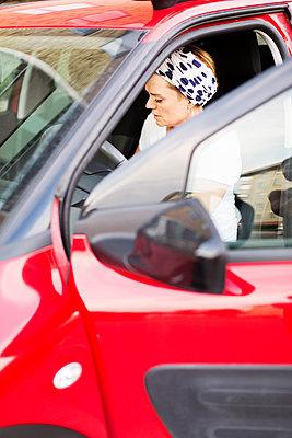 Woman in car - p312m2092058 by Pernilla Jangendahl Lilja