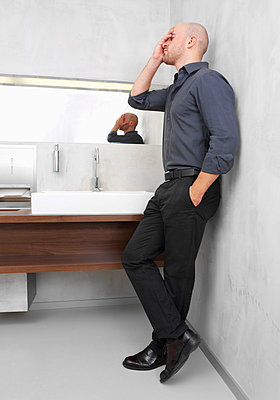 Exhausted businessman in restroom - p4736583f by STOCK4B-RF