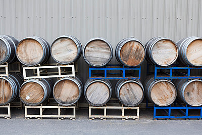 Stacked wine barrels at a winery - p301m714317f by Patrick Strattner
