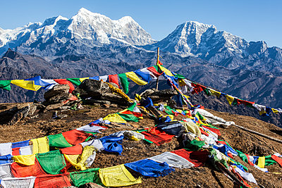Buddhist prayer flags at the summit of Pikey Peak in the Himalayas; Nepal - p442m1580393 by Alexander Macfarlane