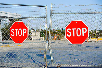 Stop signs on gates - p9246559f by Image Source