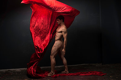 Naked man poses with red cloth - p1139m1503073 by Julien Benhamou