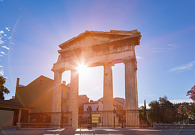 Sunlight on gate of athena archegetis ruins, Athens, Attiki, Greece, Europe - p429m1477783 by Henglein and Steets