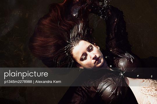 Woman in a lake - p1345m2278988 by Alexandra Kern