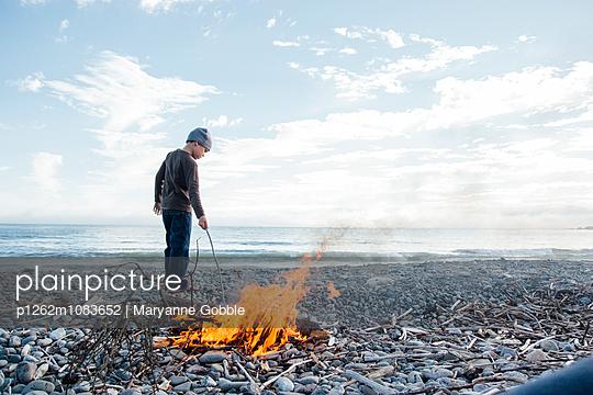 Boy Building Beach Bonfire - p1262m1083652 by Maryanne Gobble