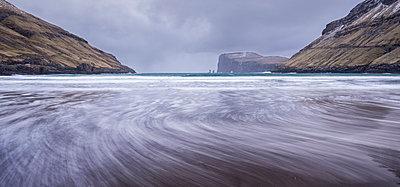 Waves crash against the black sandy beach at Tjornuvik on the island of Streymoy, Faroe Islands, Denmark, Europe - p871m1048038 by Adam Burton